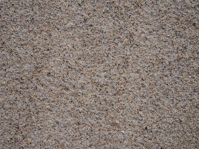 Het zand en het strand, perfectioneren voor een achtergrond of een behang royalty-vrije stock afbeeldingen