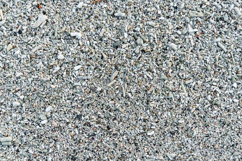 Het zandclose-up van het koraalstrand voor achtergrond royalty-vrije stock afbeelding