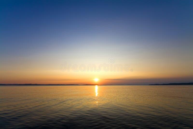 Het zeegezicht van de zonsondergang stock afbeeldingen