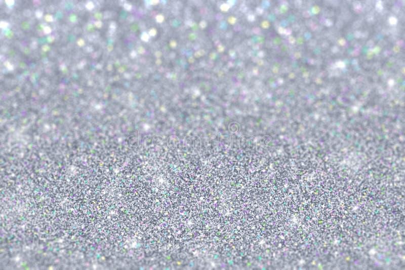 Het zilver schittert met gekleurde deeltjes defocused achtergrond stock afbeeldingen