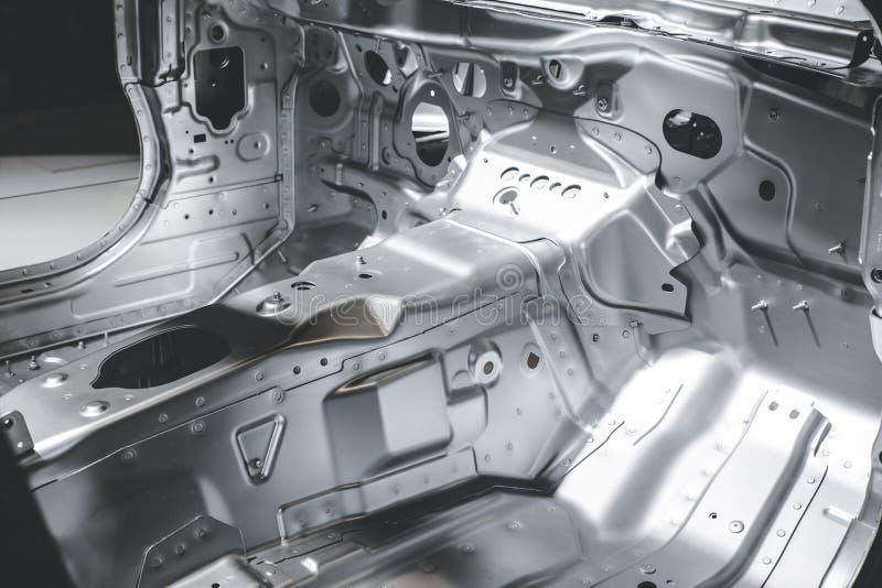 Het zilveren lichaam van de kleurenauto stock foto's