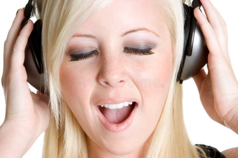 Het Zingen van de tiener stock fotografie