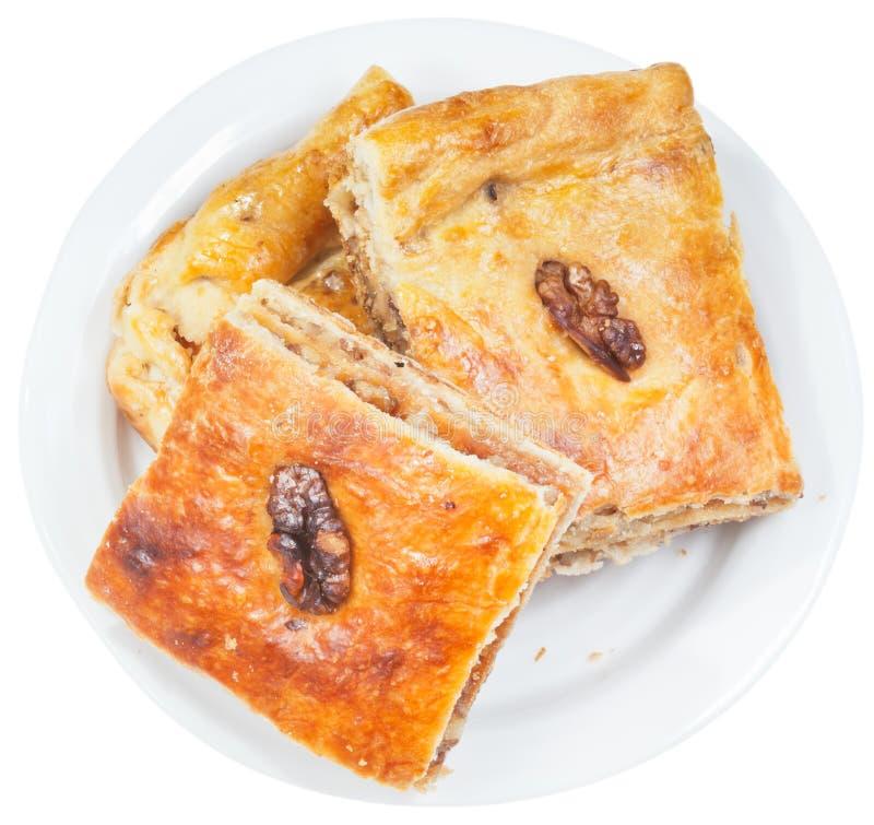 Het zoete dessert van Pakhlava met okkernoot op plaat royalty-vrije stock afbeelding