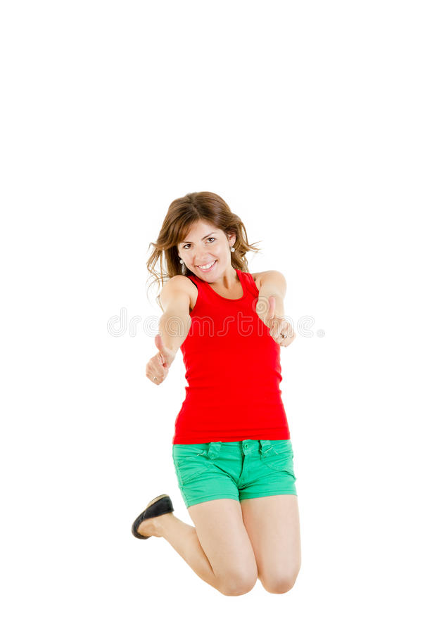 Het zoete meisje springen van vreugde het tonen beduimelt omhoog stock afbeeldingen