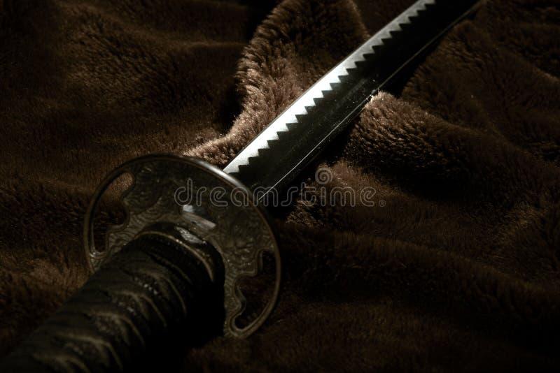 Het zwaard van samoeraien in licht stock afbeelding