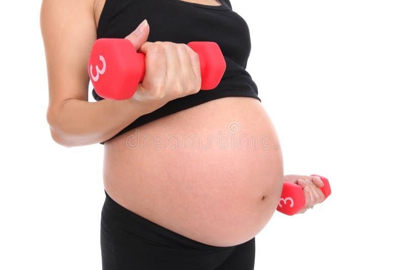 Het zwangere Uitwerken van de Vrouw stock foto