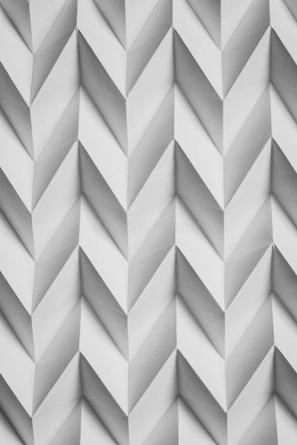 Het zwart-wit abstracte natuurlijke document gevouwen futuristische patroon van de origamifiguurzaag royalty-vrije stock fotografie