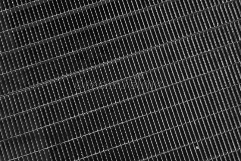 Het zwart-wit rooster van de Staalgrond Roestvrij staaltextuur, achtergrond voor website of mobiele apparaten stock foto