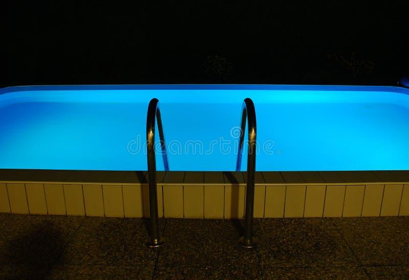 Het Zwembad van de nacht stock foto's