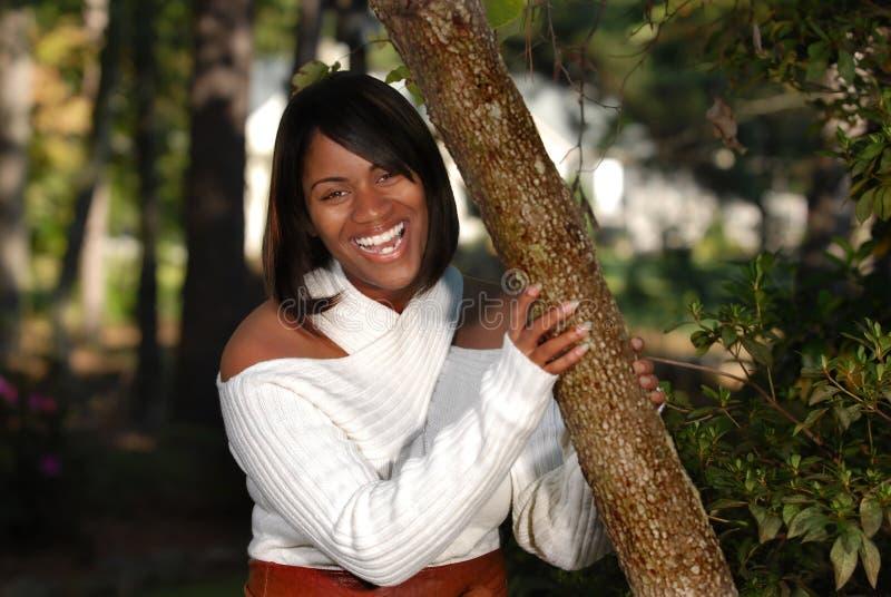 HetAmerikaanse vrouw glimlachen royalty-vrije stock afbeeldingen