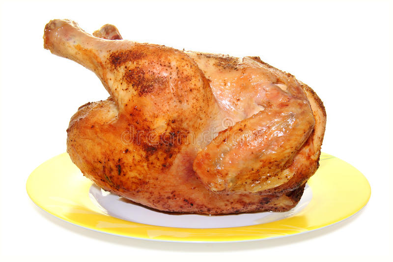 Hete geroosterde kip op een plaat stock afbeeldingen