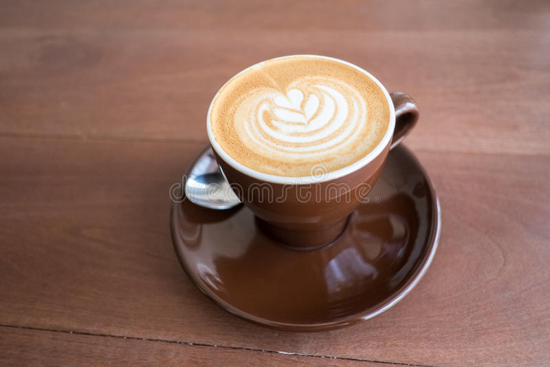 Hete koffie met latteart. stock fotografie