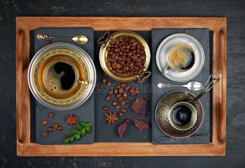Hete zwarte koffie zoete drank stock afbeelding