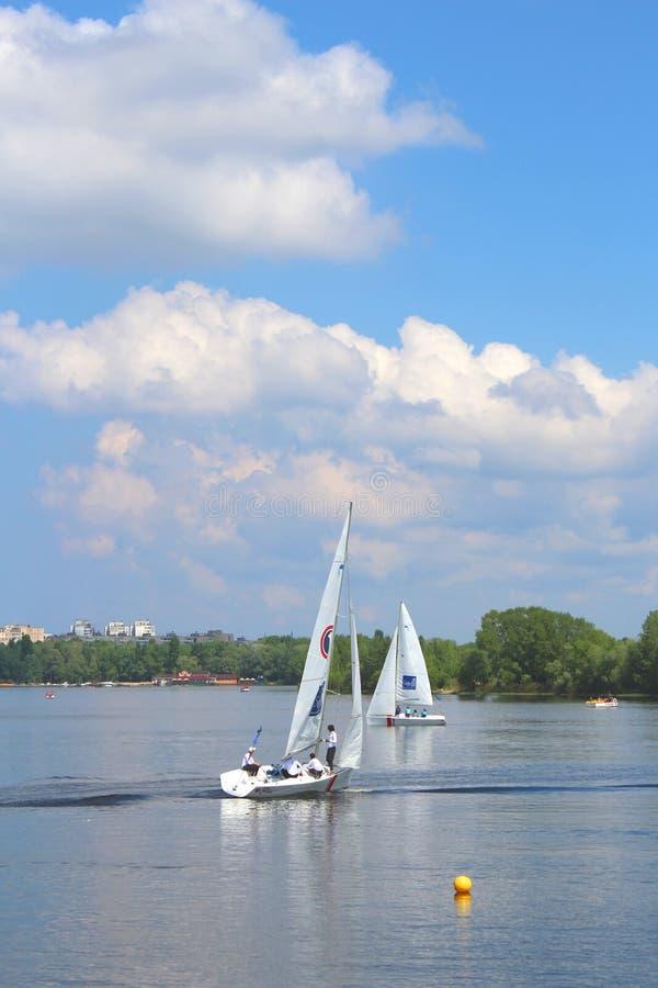 Hetman Cup 2016 Regatta, Dnipro river, Kiev, Ukraine, May 9, 2016. Unidentified yachts are preparing for the regatta. Editorial royalty free stock image