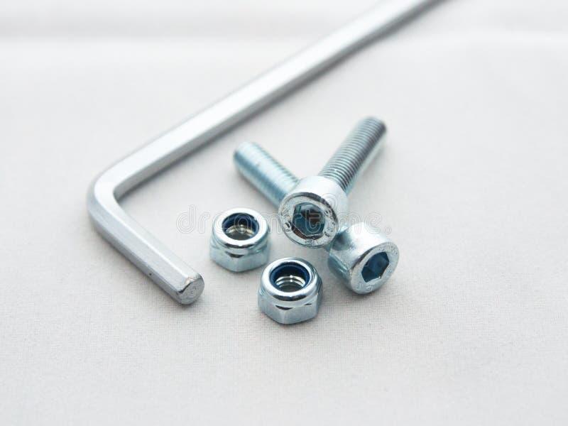 Hex klucz, rygle i dokrętki, fotografia stock