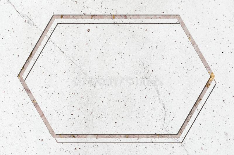Hexagon frame on white marble textured background royalty free stock photography