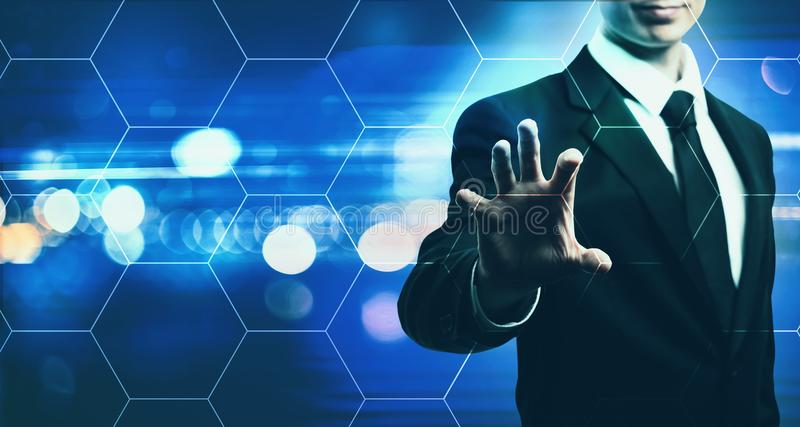 Hexagon Grid with businessman on blue light background stock photos