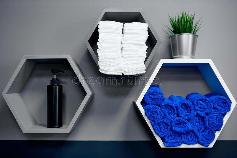 Hexagon shape gray cells with blue and white towels royalty free stock photos