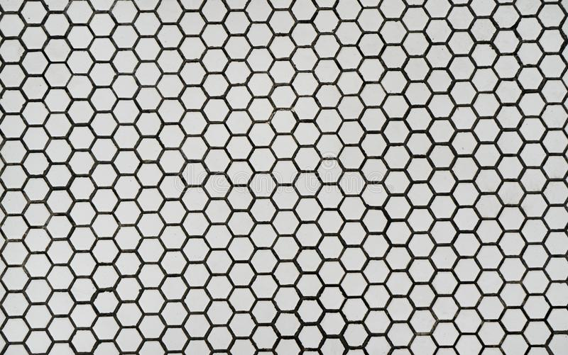 Hexagonal cell honeycomb ceramic wall stock images
