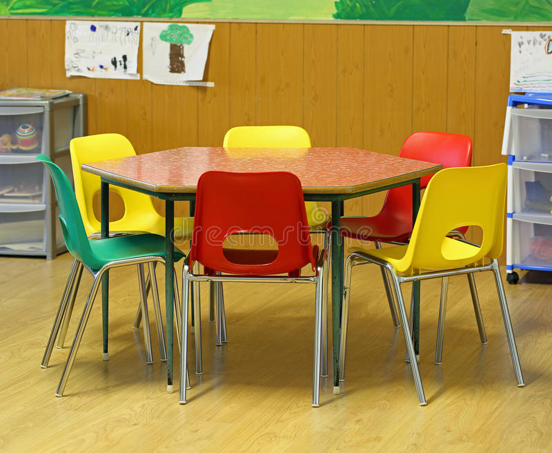 Hexagonal table with small chairs in elementary school royalty free stock photography