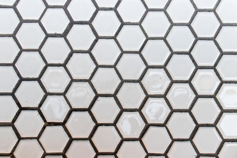 Hexagonal texture from marble surface - black lines and white ba royalty free stock image