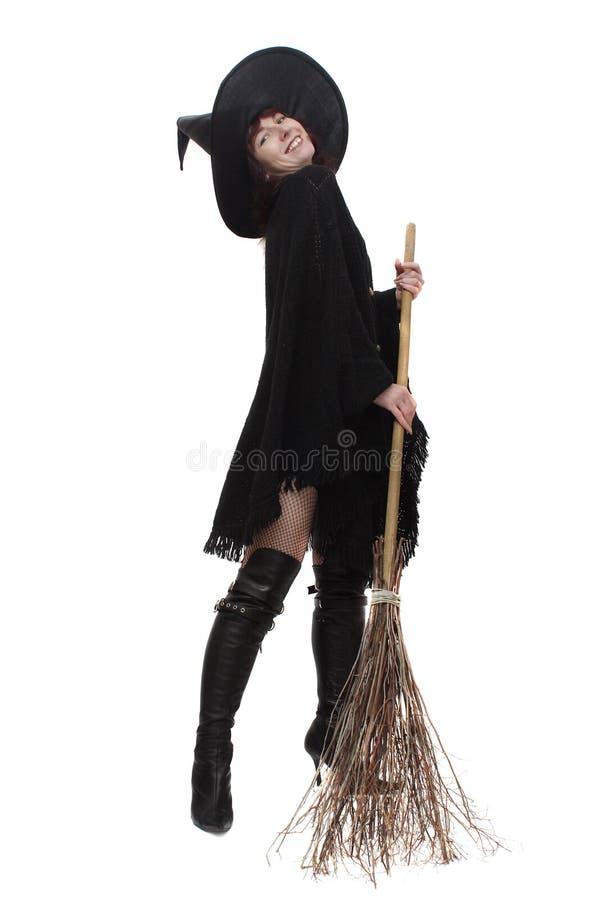 Hexe mit einem Besen lizenzfreies stockbild