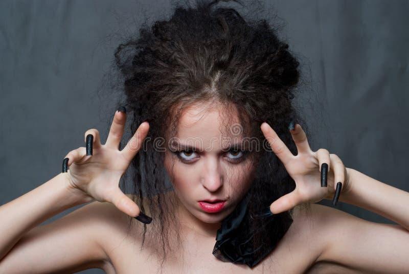 Hexe mit schwarzen Nägeln lizenzfreies stockfoto