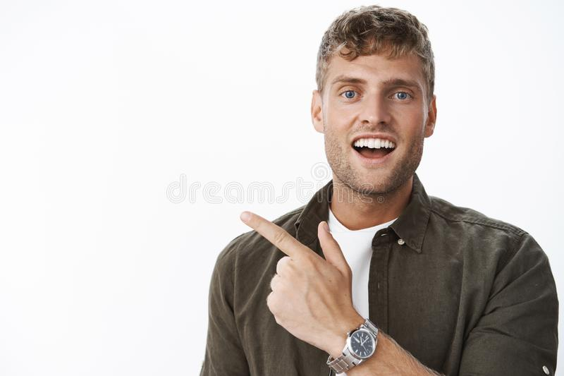 Hey check out this you gonna like it. Portrait of handsome charismatic blond guy with blue eyes and white broad smile stock images