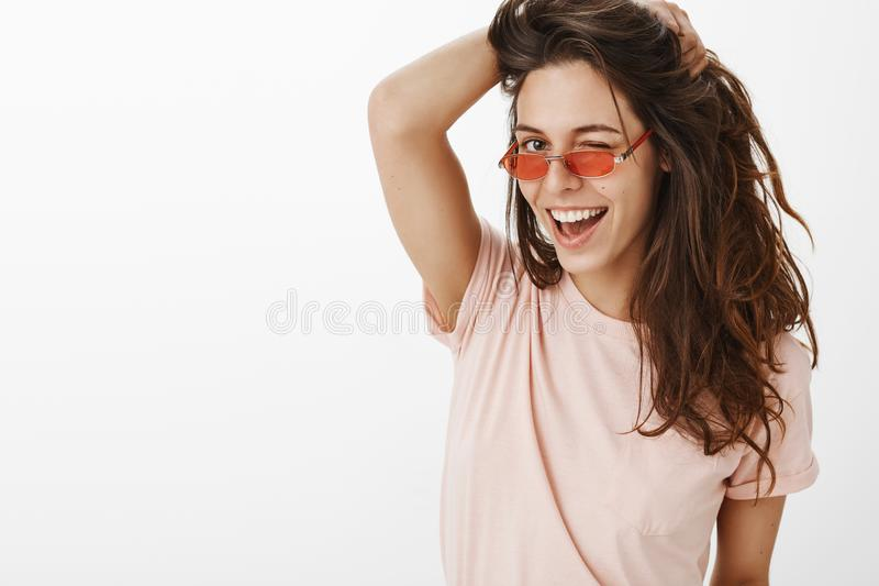 Hey handsome. Portrait of confident sensual and playful stylish young caucasian female playing with beautiful natural royalty free stock photos