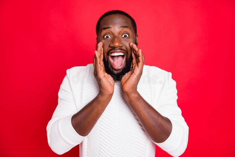 Hey listen new promo. Portrait of crazy funky african man hold hand near mouth shout ads share confidential information. Hey listen new promo. Portrait of crazy stock images
