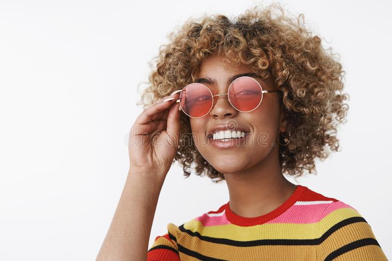 Hey what up, ready for party. Joyful and enthusiastic outgoing african-american attractive woman with blond hair and. Pierced nose wearing cool sunglasses stock photo