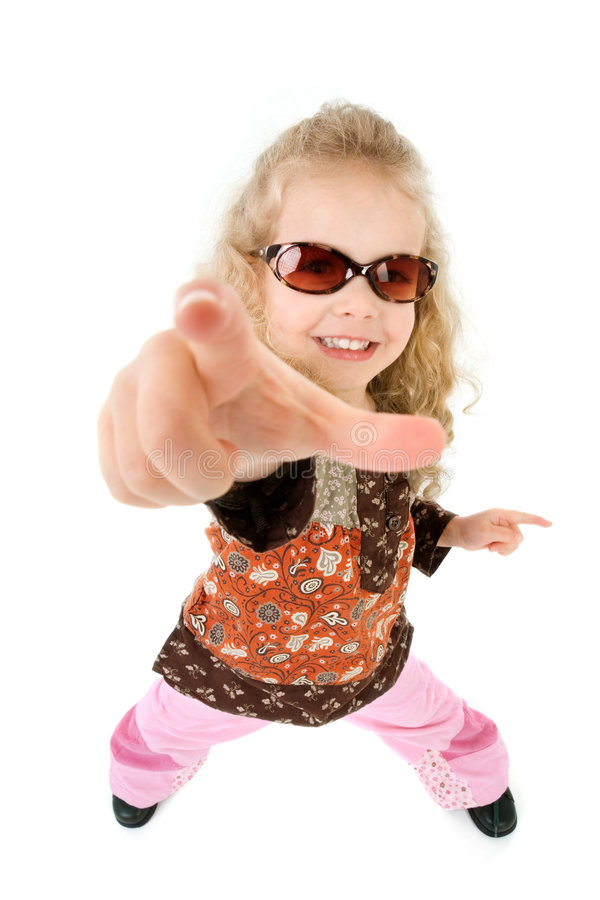 Hey you. A little girl points her finger at someone royalty free stock photo