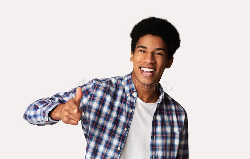 Hey you! Cheerful black guy indicating happily at camera stock images