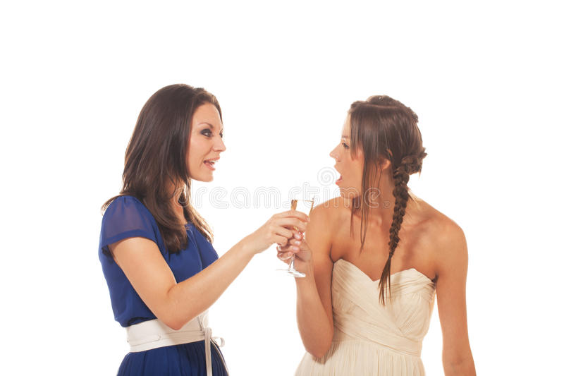Hey, you drink too much. One girl is fighting against another girl drinking too much alcohol royalty free stock photos