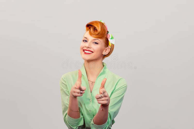 Hey you! Woman pointing index fingers gesture stock photo