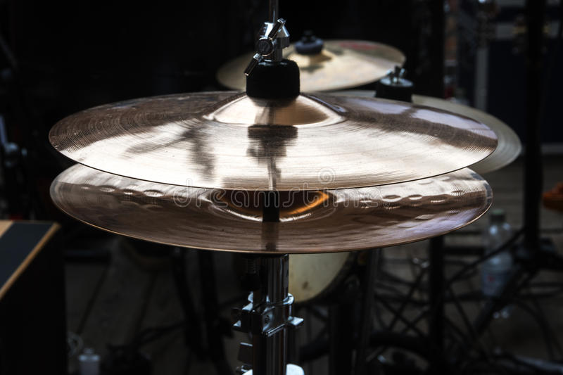 Hi-hat on stage, combination cymbal in a percussion drum kit for. Pop, rock, jazz, folk music and more, dark ambient, selected focus, narrow depth of field royalty free stock photo