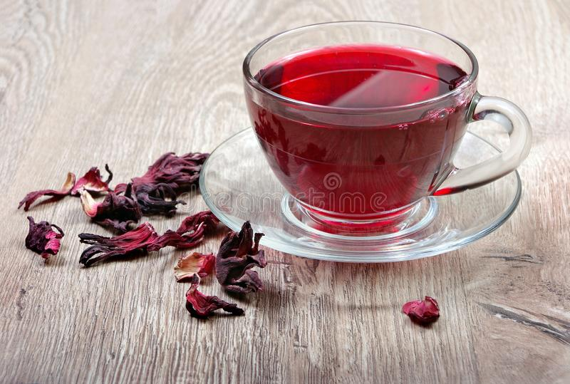 Hibiscus tea. Hibiscus tea in a wooden spoon. Vitamin tea for cold and flu. Close up royalty free stock image