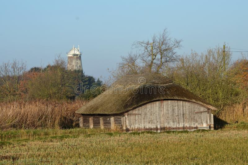 Hickling Broad Norfolk UK Thatched Boathouses stock photo