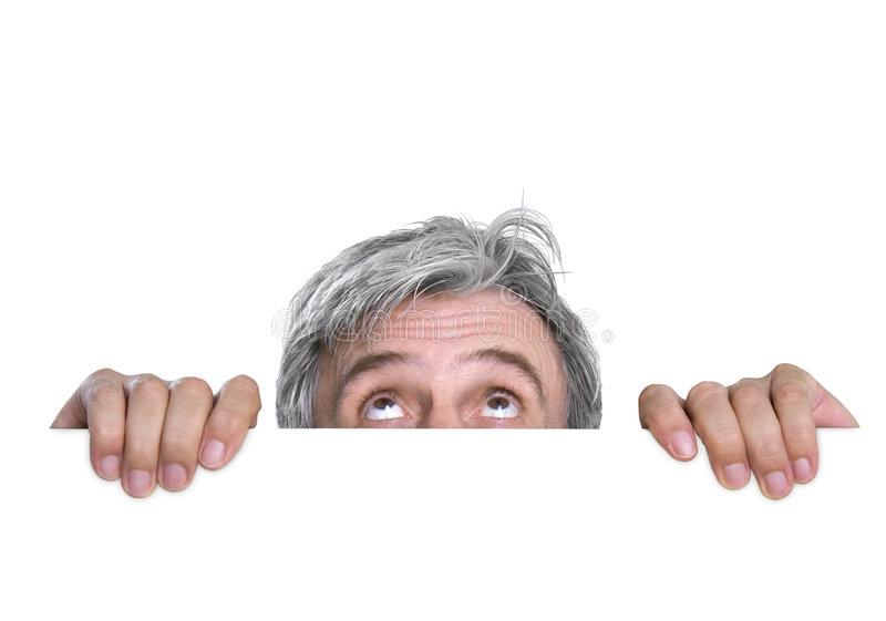Hidden. Timid gray-haired man royalty free stock image