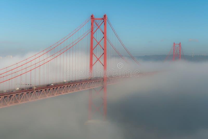 Hidden bridge. In fog days part of the 25th bridge on Lisbon disappears royalty free stock image