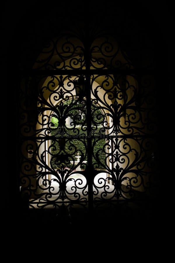 Hidden garden behind the gate stock images