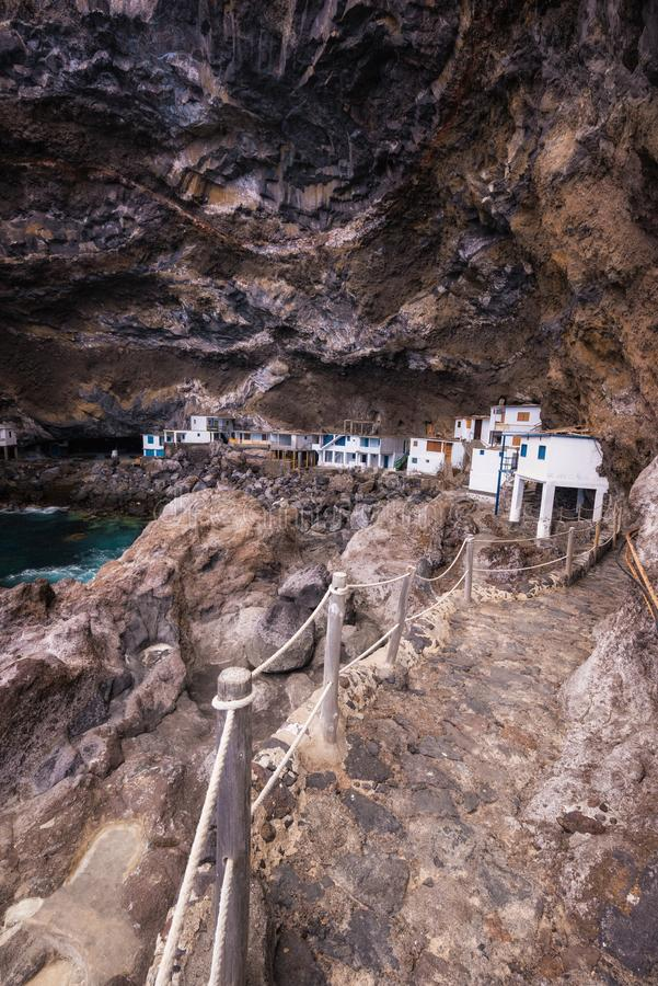 Hidden houses in the tourist attraction pirate cave of El Poris stock photos