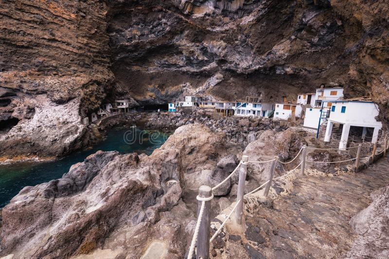 Hidden houses in the tourist attraction pirate cave of El Poris stock image