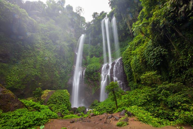 Hidden in jungles beautiful Sekumpul waterfall on Bali, Indonesia royalty free stock photo