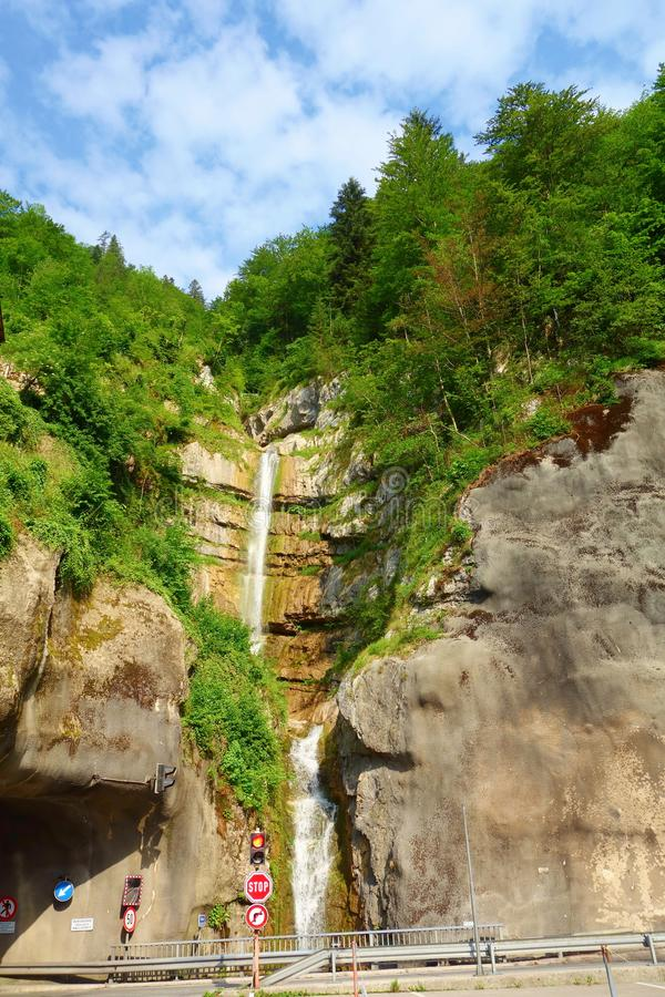 Hidden mountain waterfall in the beautiful and popular village of Hallstatt located in Austria, Europe. Hidden mountain waterfall in the beautiful and popular royalty free stock photography