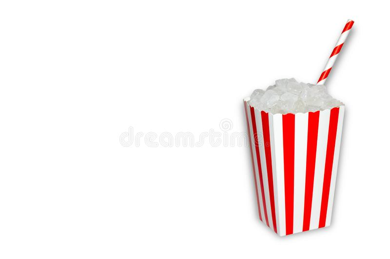Hidden sugar in food and soft drinks, beverages, a popcorn box full of sugar cristal cubes with a straw on white background with royalty free stock photos