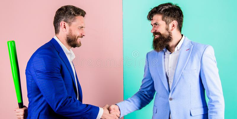Hidden threat concept. Business partners competitors office colleagues shaking hands. Tricky first impression. Do not stock photos