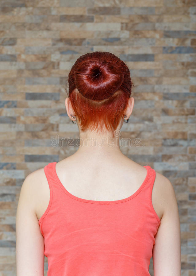Hidden undercut hair 1. Young model with topknot and hidden undercut on hair royalty free stock image