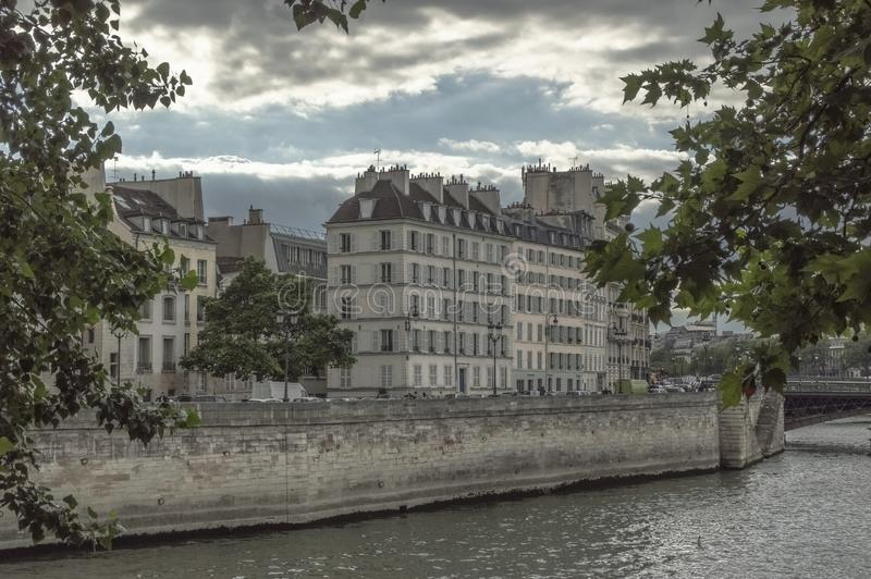 A hidden view point to Parisian houses on the embankment royalty free stock photography