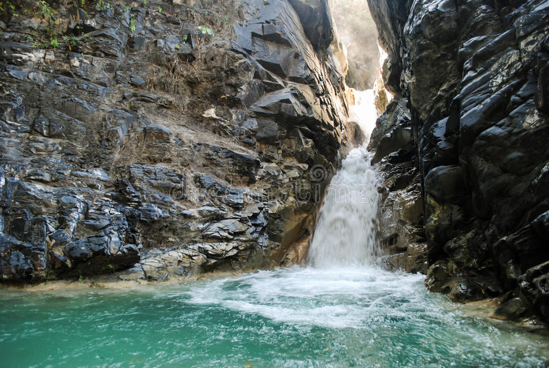 Hidden waterfall in Sumba island. Waterfall hidden in the forest near city of Waingapu, East Sumba royalty free stock photos